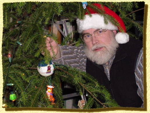Norm adding his new ornament to the tree on 12/20/00.